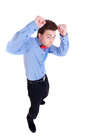 loser: businessman in a tie butterfly in a fighting stance. backside view of person. the little man fighting with their fists. Stock Photo
