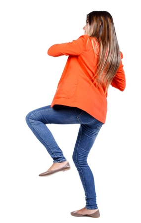 loser: back view of woman funny fights waving his arms and legs. business woman in a red jacket kicks.