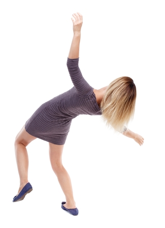 stumble: Balancing young woman. or dodge falling woman. Isolated over white background. Blonde in violet short dress falls on his back.