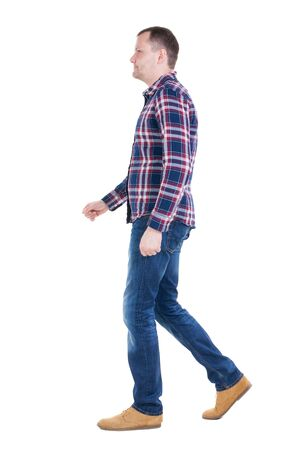 Back view of going  handsome man in checkered shirt. walking young guy . Rear view people collection.  backside view of person.  Isolated over white background. Stock Photo