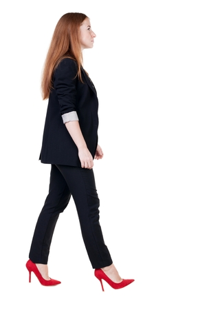 treading: walking red head business woman. back view. going young girl in  suit. Rear view people collection.  back side view of person.  Isolated over white background.