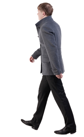 Back view of going  handsome business man in coat.  walking young businessman . Rear view people collection.  backside view of person.  Isolated over white background.