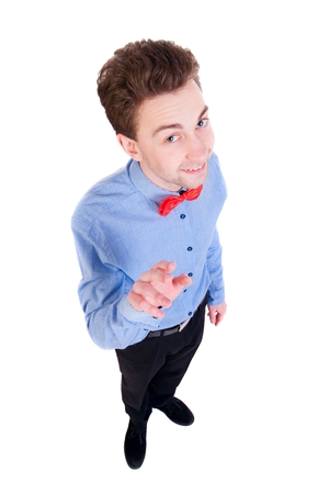 finger bow: Smiling businessman in a bow tie looking up. top view. Satisfied businessman shakes his finger. Stock Photo