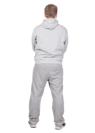 Back view of young men athlete  Guy in tracksuit looks away. Rear view. Isolated over white background. Stock Photo