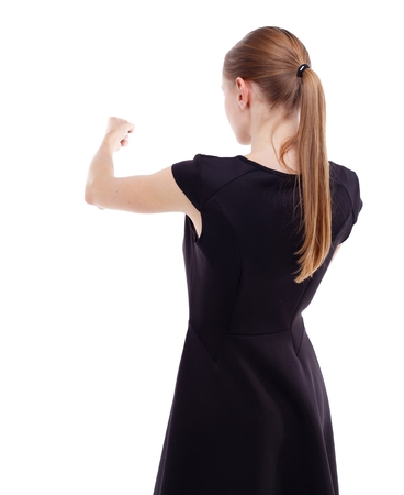 wimp: skinny woman funny fights waving his arms and legs. Isolated over white . Blonde in a short black dress punches.