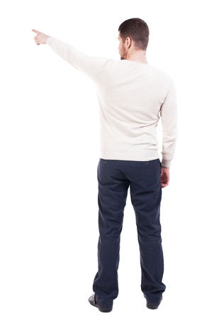 powerfully: Back view of pointing business man. gesticulating young guy in black suit. Rear view people collection.  backside view of person.  Isolated over white background. office worker in a shirt and trousers powerfully indicates something Side. The bearded guy s