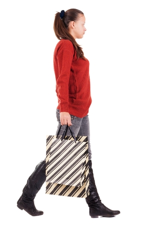 go shopping: back view of going  woman  with shopping bags . beautiful brunette girl in motion.  backside view of person.  Rear view people collection. Isolated over white background.