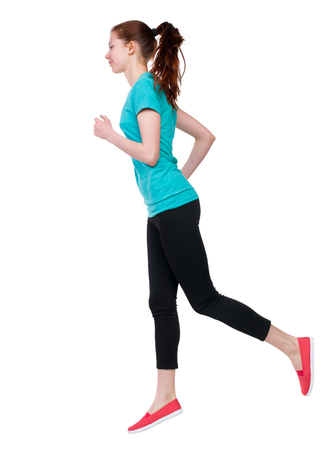 back view of running sport woman. beautiful girl in motion. backside view of person.  Rear view people  collection. Isolated over white background. Sport girl in black tights running jogging. Stock Photo