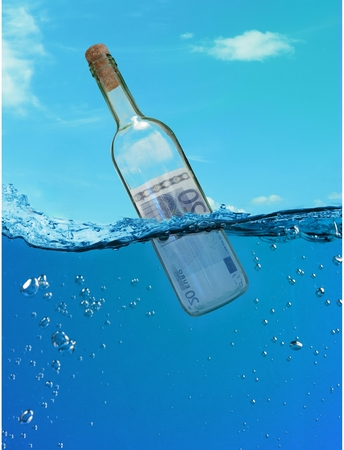Concept  financial assistance. Bottle of money floating in the water. Stock Photo