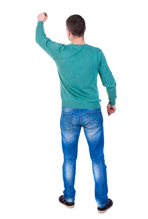 back view of writing business man. man in a green jacket and jeans marker writing on the wall. Stock Photo