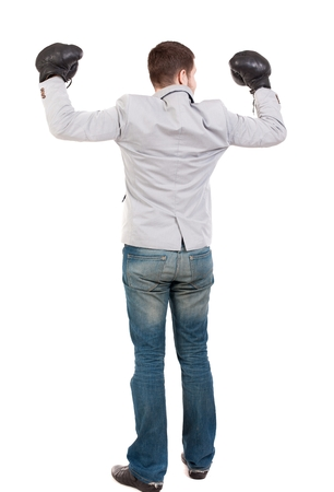 wimp: businessman with boxing gloves in fighting stance. Man in gray suit and boxing gloves celebrating the victory.