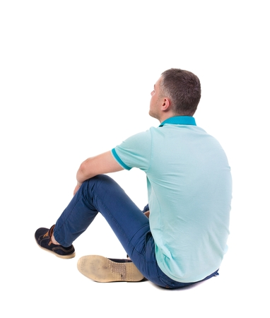 Back view of seated handsome man in polo looking up.   Standing young guy in jeans. Rear view people collection.  backside view of person.  Isolated over white background. Stock Photo
