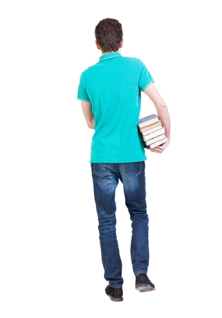Back view of going  handsome man carries a stack of books. walking young guy . Rear view people collection.  backside view of person.  Isolated over white background. A guy with a small stack of books out into the distance.