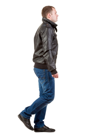 treading: Back view of going  man in jacket.  walking young guy in jeans and  jacket. Rear view people collection.  backside view of person.  Isolated over white background. Stock Photo