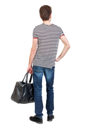 striped vest: Back view of man with with a bag. Curly boy in a striped vest holding bag holding her hands on her waist.