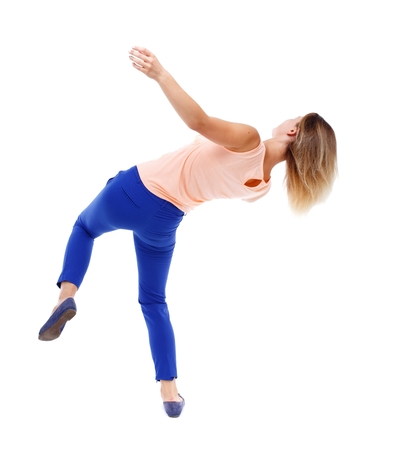 caida libre: Balancing young woman. or dodge falling woman. Isolated over white background. The blonde in a pink t-shirt in freefall