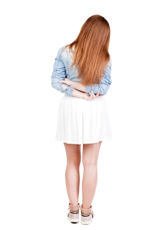 back view of standing young red head woman. Rear view people collection.  backside view of person.  Isolated over white background.