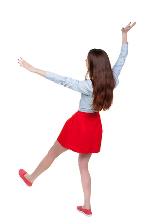 stumble: Balancing young woman. or dodge falling woman. Long-haired brunette in red skirt falls on his back.