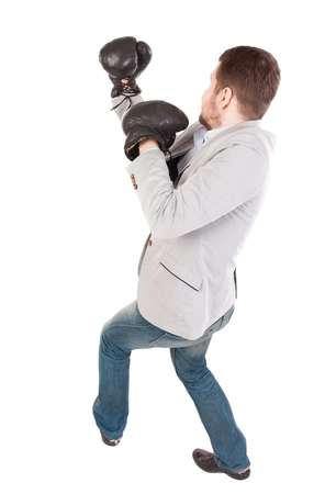 businessman with boxing gloves in fighting stance. Top view of a businessman in boxing gloves fighting. Stock Photo