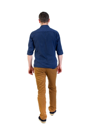 Back view of going handsome man. walking young guy . man in a blue shirt with the sleeves rolled up out of the frame. Stock Photo