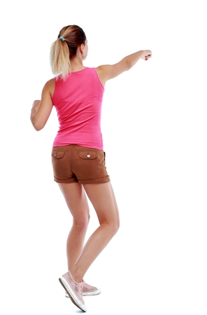 wimp: back view of woman funny fights waving his arms and legs. Isolated over white background. Sport blond in brown shorts fighting with their fists. Stock Photo