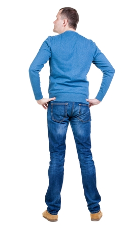 standing up: Back view of handsome man in blue pullover looking up.   Standing young guy in jeans. Rear view people collection.  backside view of person.  Isolated over white background.