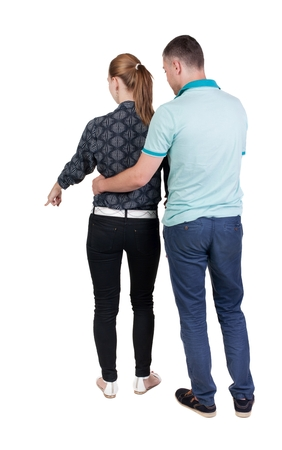 backside: young couple pointing. Back view.  Rear view people collection.  backside view of person.  Isolated over white background.