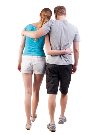 to move forward: Back view of going young couple (man and woman). walking beautiful friendly girl and guy in shorts together. Rear view people collection. backside view of person.  Isolated over white background. friends firmly pressed move forward
