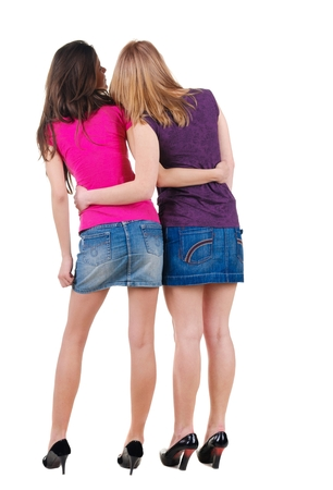 two persons only: Two young woman. Rear view. Isolated over white