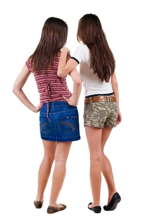backside: Two young  women friend.  backside view of person. Isolated over white background. Rear view people collection. Stock Photo