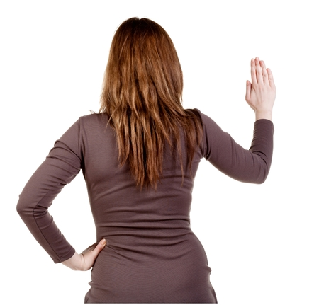 bisiness: back view of Businesswoman . Young bisiness woman in dress presses down on something. Isolated over white background. Rear view people collection. backside view of person.