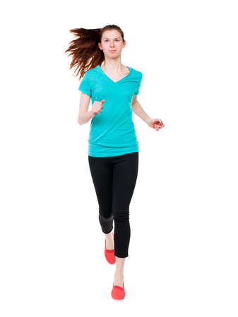 front view of running sport woman. beautiful girl in motion. Sport girl in black tights with runs flowing hair.