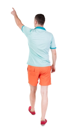 Back view of going  handsome man in shorts.  walking young guy . Rear view people collection.  backside view of person.  Isolated over white background. Stock Photo