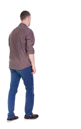 Back view of going  handsome man in jeans and a shirt.  walking young guy . Rear view people collection.  backside view of person.  Isolated over white background. Stock Photo