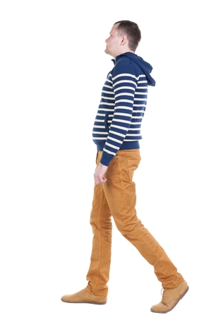 Back view of walking handsome man in jeans and striped sweater.  young guy going . Rear view people collection.  backside view of person.  Isolated over white background. Stock Photo