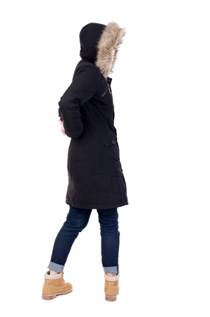 parka: Back view woman in winter jacket  looking up.   Standing young girl in parka. Rear view people collection.  backside view of person.  Isolated over white background. Stock Photo