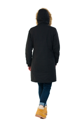 treading: Back view of going  woman in parka. walking young girl. Rear view people collection.  backside view of person.  Isolated over white background. Wearing a hood on his head girl goes away.
