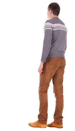Back view of going  handsome man in jeans and sweater.  walking young guy in jeans and  jacket. Rear view people collection.  backside view of person.  Isolated over white background. Stock Photo