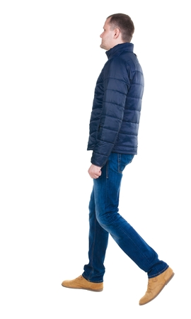 Back view of going  handsome man in jeans and jacket.  walking young guy . Rear view people collection.  backside view of person.  Isolated over white background. Stock Photo