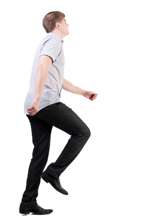 rushes: back view of running business man . walking businessman in motion. Rear view people collection.  backside view of person. Isolated over white background. quickly rushes young man in office clothes somewhere