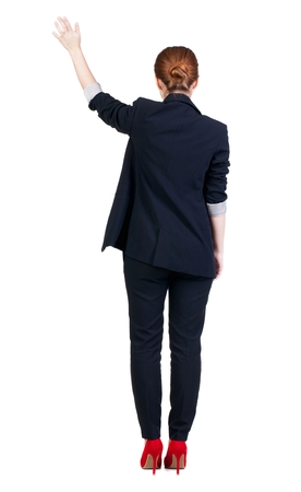 Back view of beautiful business woman welcomes.  Young girl in suit. Rear view  people collection.  backside view of person.  Isolated over white background.