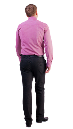 treading: back view of walking  business man.  going young guy in red shirt. stylishly dressed in formal wear young man. Isolated over white background. guy comes to the workplace. Rear view people collection.  backside view of person. Stock Photo