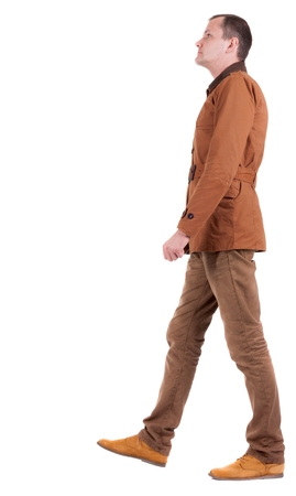 stylishly: Back view of going  stylishly dressed man in a brown jacket.  walking young guy. Rear view people collection.  backside view of person.  Isolated over white background.