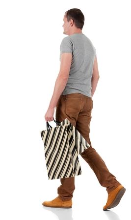 go shopping: Back view of going  handsome man with shopping bags.  walking young guy in jeans and  jacket. Rear view people collection.  backside view of person.  Isolated over white background.
