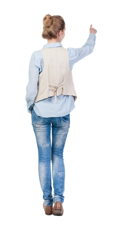 vest in isolated: back view of woman. Young woman in vest presses down on something. Isolated over white background. Rear view people collection. backside view of person. she holds his hand open, palm forward