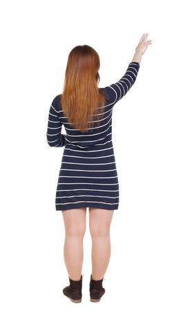 fingers on top: Back view of  pointing woman. beautiful girl. Rear view people collection.  backside view of person.  Isolated over white background. Girl shows two fingers of the hand to the top