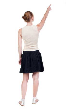 backside: Back view of  pointing woman. beautiful blonde girl. Rear view people collection.  backside view of person.  Isolated over white background.