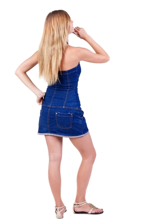 Back view of  thinking young beautiful woman. Rear view. isolated over white background. Concept of idea, ask question, think up, choose, decide. Stock Photo