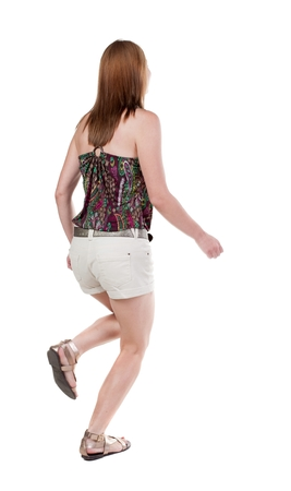 back view of running  woman white shorts. beautiful blonde girl in motion. backside view of person.  Rear view people collection. Isolated over white background.