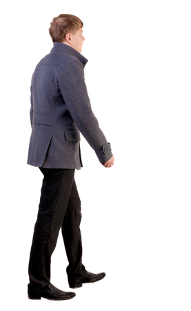 Back view of going  young business man in gray coat.  walking young businessman . Rear view people collection.  backside view of person.  Isolated over white background.